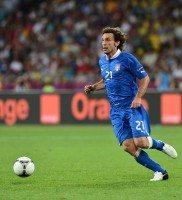 Italian midfielder Andrea Pirlo runs wit