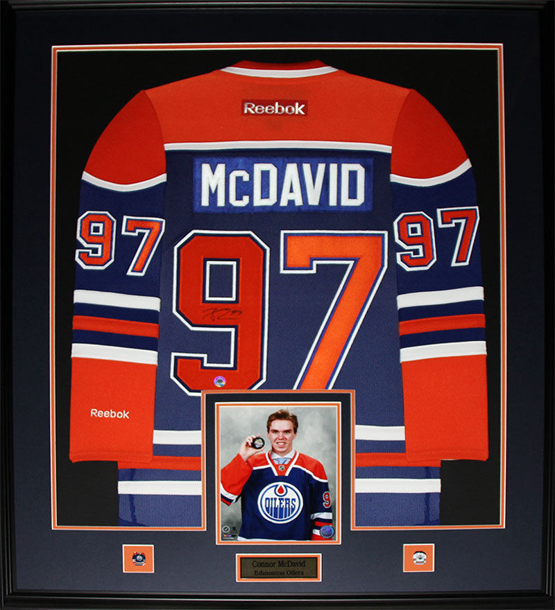 https://dglsports.ca/wp-content/uploads/2018/09/McDavid-signed-and-Framed-Jersey.jpg